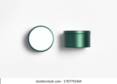 Empty Metal Box Mock up with blank label isolated on white background. Steel container or accessory package for your design.Round tin. High resolution photo.Front and top view.