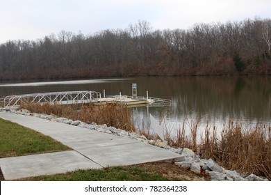 The empty metal dock at the park on a cloudy winter day.