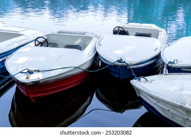Empty metal pedal boats from slightly above at a lake