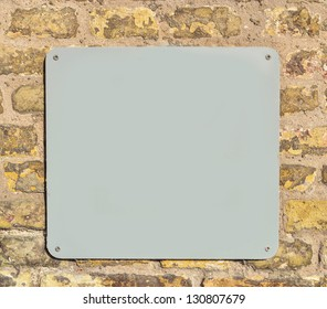 Empty metal plate on brick wall