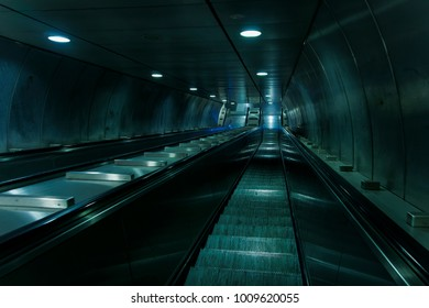 Empty metro escalator stairs. Electric stairs with no crowd moving down inside Rome metro, Italy..