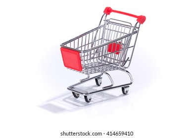 Empty miniature shopping cart, isolated on white background