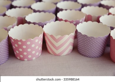 Empty mix paper cupcake cases,selective focus, vintage tone