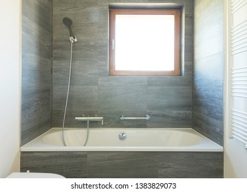 Empty modern bathroom interior with stone, ready to be inhabited.