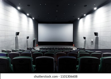 Empty modern cinema with blank white screen