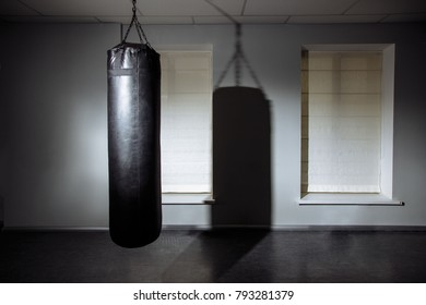 Empty modern fight club with punching bag for practicing martial arts