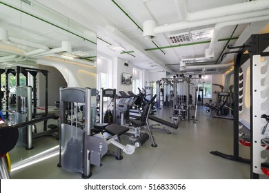 Empty modern gym with new shiny fitness equipment for sport training