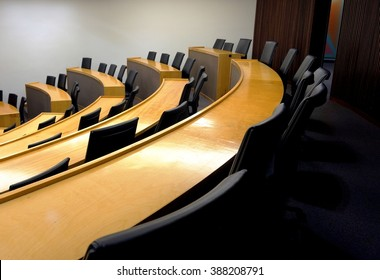 An empty modern lecture style university classroom