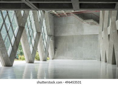Empty modern loft with concrete  floor and big Windows