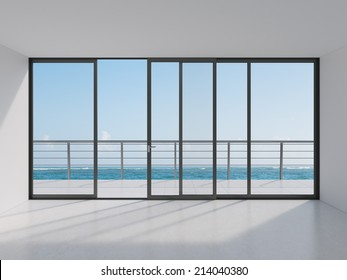 Empty modern lounge area with large windows and view of sea