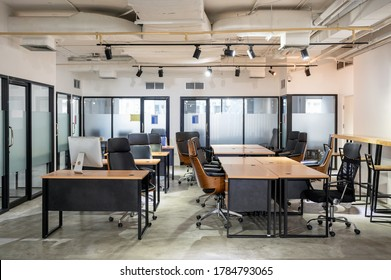 Empty modern office with desk and chair temporarily closed from government measures protective during pandemic of Coronavirus, Covid-19