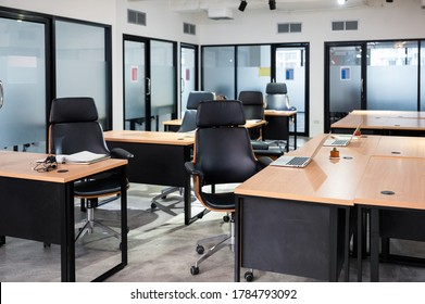 Empty modern office with desk, chair, laptop temporarily closed from government measures protective during pandemic of Coronavirus, Covid-19