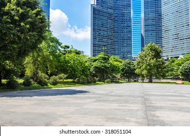empty, modern square and skyscrapers under sunbeam