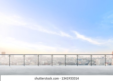 Empty modern terrace area with city view over blue sky background