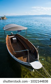 An empty motor boat on a sunny day waiting for passengers in Macedonia.