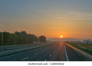 Empty motorway at sunrise, low traffic