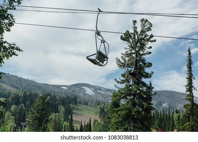 Empty mountain ski lift chair at summer time.