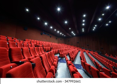 Empty movie theater with red seats