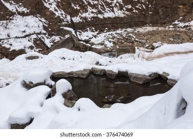 Empty natural hot spring pond (no Snow monkey) at Jigokudani Wild Monkey Park, Yamanouchi-machi, Nagano ken, Japan.
