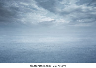 Empty nature background, frozen lake with dramatic sky