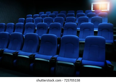empty new blue seats in auditorium or movie theater