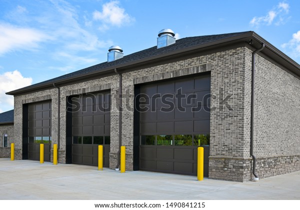 Empty New Brick Commercial Building with Three Large Garage Doors