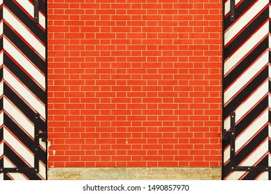Empty new brick wall texture with two striped gate doors. Red stonewall background. Abstract web banner. Copy-space. Vintage style