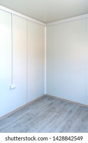 Empty new room interior corner with white walls and wooden floor