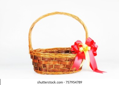 Empty new year vintage basket gift with red-gold ribbon bow on copy space background