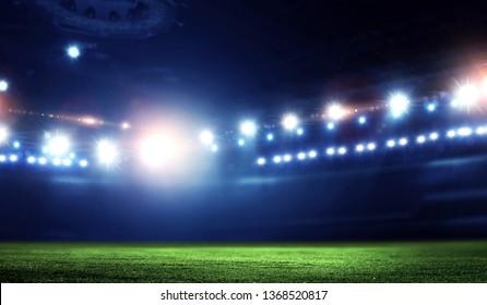 Empty night football arena in lights