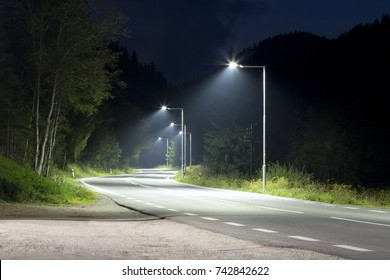 empty night road with modern streetlights