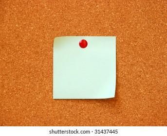 empty note pad on cork board