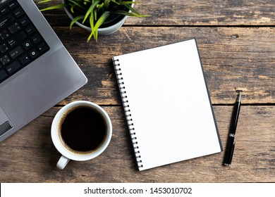 empty notebook with coffee and computer on wooden table ,top view - Shutterstock ID 1453010702
