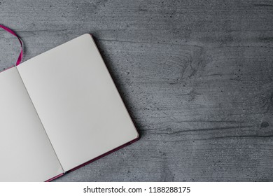 Empty notebook on the office table. Top view image, copy space