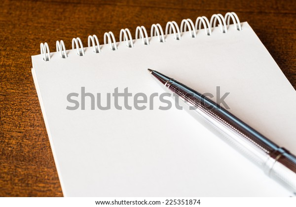 Empty notebook with a pen on the table