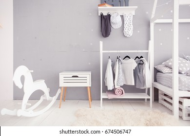 Empty nursery room with clear wall, toys and wooden horse
