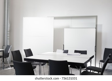Empty office meeting room with chair, table and white board