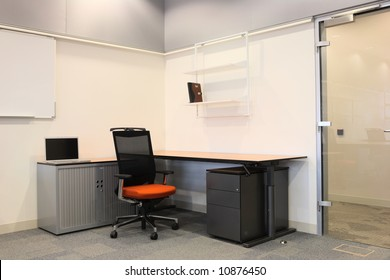 Empty office with new modern office furniture, including desks, cupboards, filing cabinets and chairs. Two blue chairs facing out. HDR type image