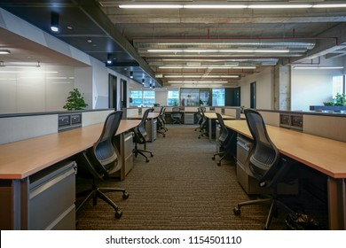 Empty office with Original concrete ceiling and wooden furniture.
