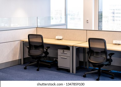 Empty office room with chairs wooden table and power outlet architecture and nobody by cubicle corporate desk