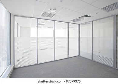 Empty office room with glass walls and doors