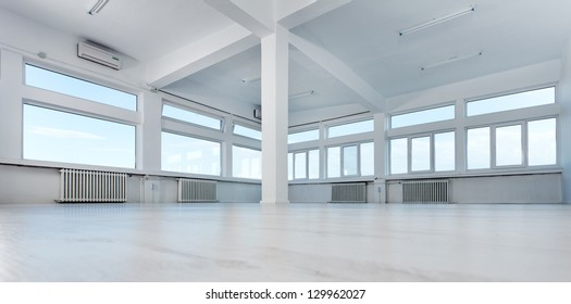 Empty office space with large windows