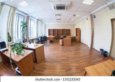 Empty office space with tables, cabinets and flowers, nobody, wide angle view