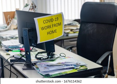 Empty office space while officer is working from home to avoid corona virus. Worker follows social distancing and stays at home to prevent COVID-19 or 2019-nCoV infection and reduce pandemic.