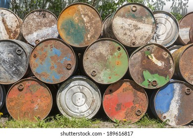 Empty oil barrels, rusty and weathered
