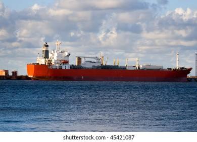 Empty oil tanker is loading in port of Ventspils, Latvia.