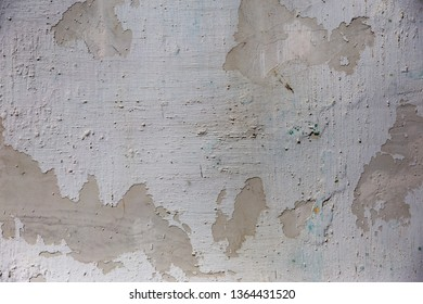 Empty old art texture of plaster brick wall. Painted bad scratched surface in fissures of painted stucco of stone brick wall with petal texture. rubbed facade of building with damaged plaster