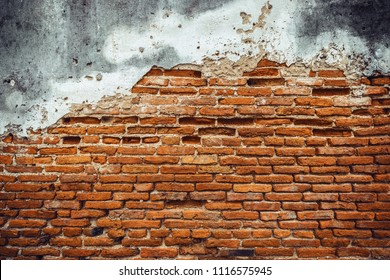 Empty Old brick wall with peeling plaster backdrop, Cracked concrete brick wall, Damaged brick wall, background and texture
