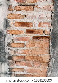 Empty Old Brick Wall Texture. Painted Distressed Wall Surface. Grungy Wide Brickwall. Grunge Red Stonewall Background. Shabby Building Facade With Damaged Plaster.