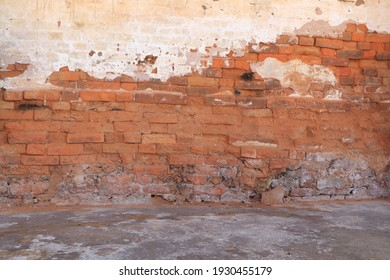 Empty Old Brick Wall Texture. Painted Distressed Wall Surface. Grunge Red Stonewall Background. Shabby Building Facade With Damaged Plaster. Abstract Web Banner. Copy Space.